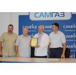 Андрій Марков отримав почесну грамоту і пам'ятну монету в присутності трудового колективу ТОВ «Самгаз»  від представників газопостачальної компанії ПАТ «Рівнегаз»